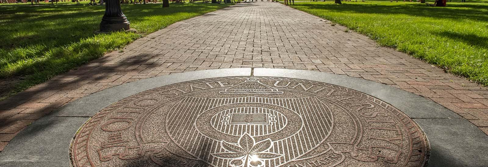 Photograph of university seal on the Oval walkway
